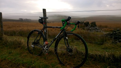 tough, good brakes, green bar tape. Ready for the hard (and wet) miles...
